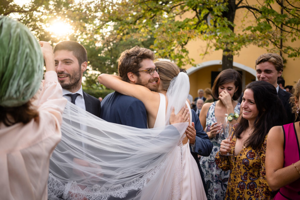 bride wedding top photographer Italy Piedmont emotional pictures moments special day flowers hugs weddings authorial pictures friends sunset