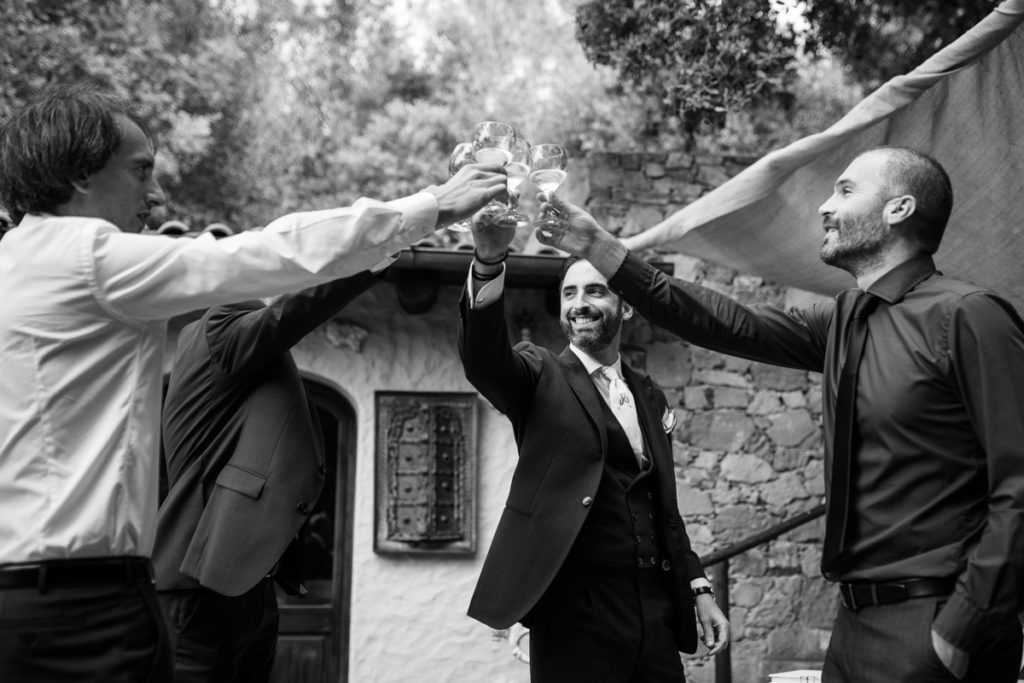groom style wedding photographer reportage friends elegance Finale Ligure La Ginestra weddings location events lifestyle shoes man cheers prosecco champagne italian riviera