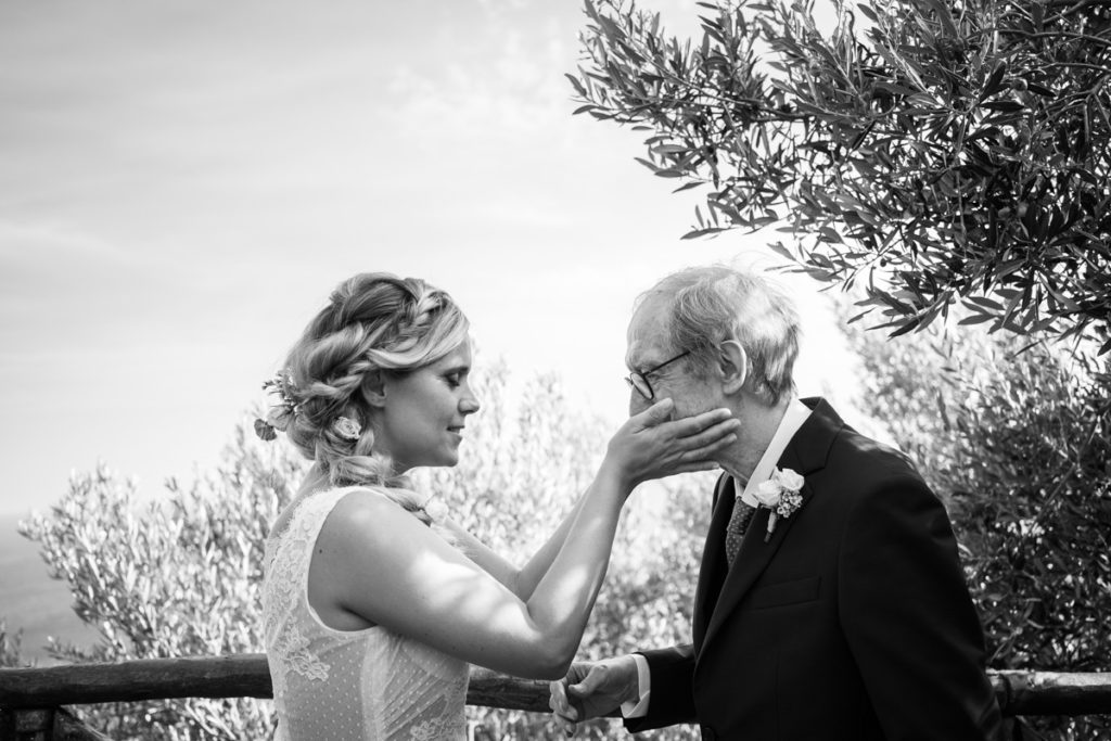 bride wedding photographer reportage emotions dad best day olives tree caress Liguria Italy events location Villa Ulivi Finale Ligure elegance records shooting emotional photos