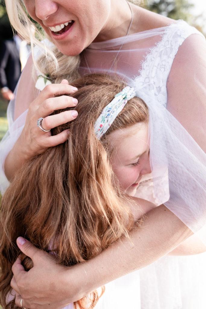 cerimony wedding photographer reportage cry bride groom La Ginestra Liguria Italy elegant summer events best location sunset hugs kids kid