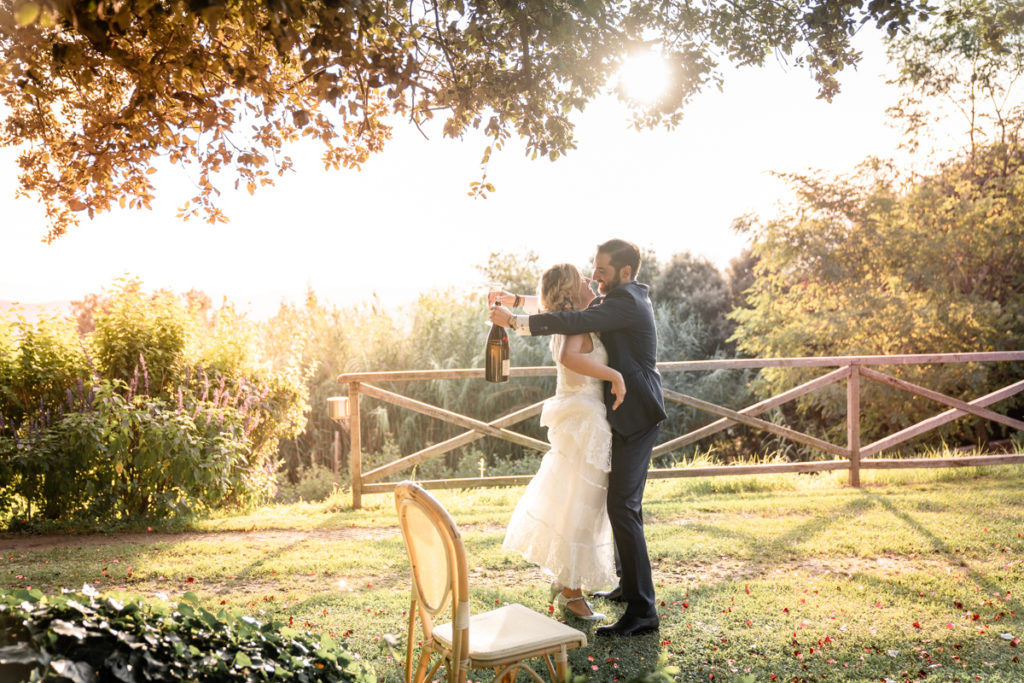 cerimony wedding photographer reportage cry bride groom La Ginestra Liguria Italy elegant summer events best location sunset hugs prosecco cheers champagne